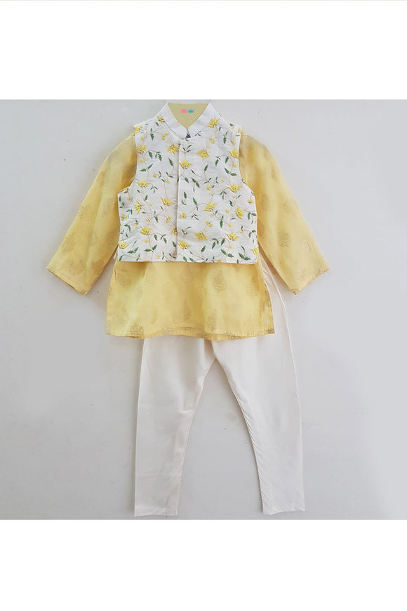 White embroidered jacket and yellow kurta with churidar