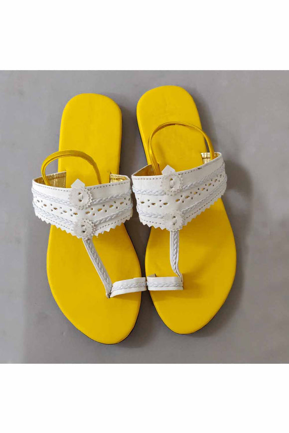 Yellow and white kolhapuri! Footwear for girls, Flip flop for girls, designer sandals for girls, belly shoes for girls, designer kolhapuri flats