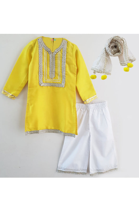 Yellow kurti and white palazzo with dupatta
