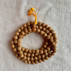 11mm Bodhi Seed Mala (Prayer Beads) with smooth beads and yellow string
