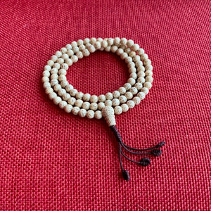 5mm Lotus Seed Mala with brown string and adjustable knot