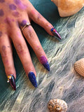 Nails submitted for assessment following nails course at beauty academy Foundations - with shells and glitter
