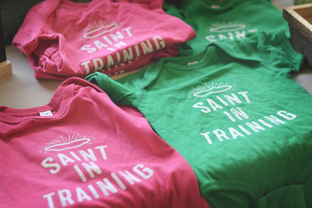 saint in training onesie