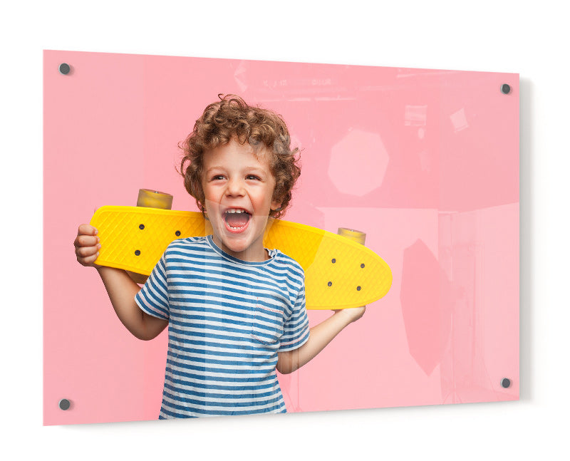 Acrylic Print of a Photo of a ChildHolding a Skateboard and Smiling