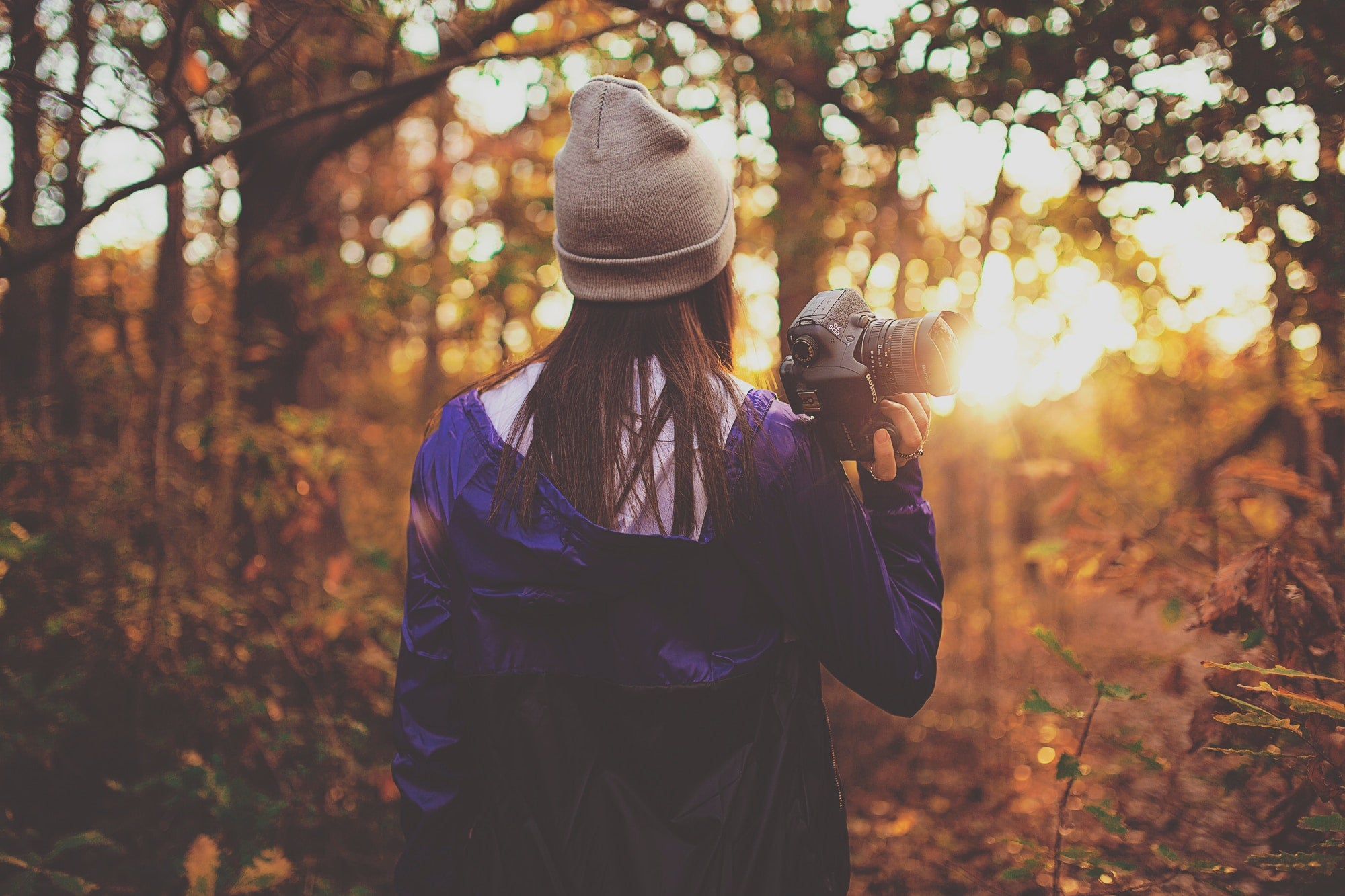 Woman with Camera Capturing Autumn Photos
