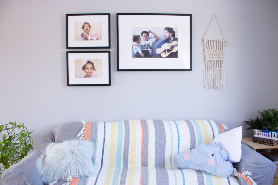 Family Room Displaying a Gallery Wall of Framed Prints by Posterjack