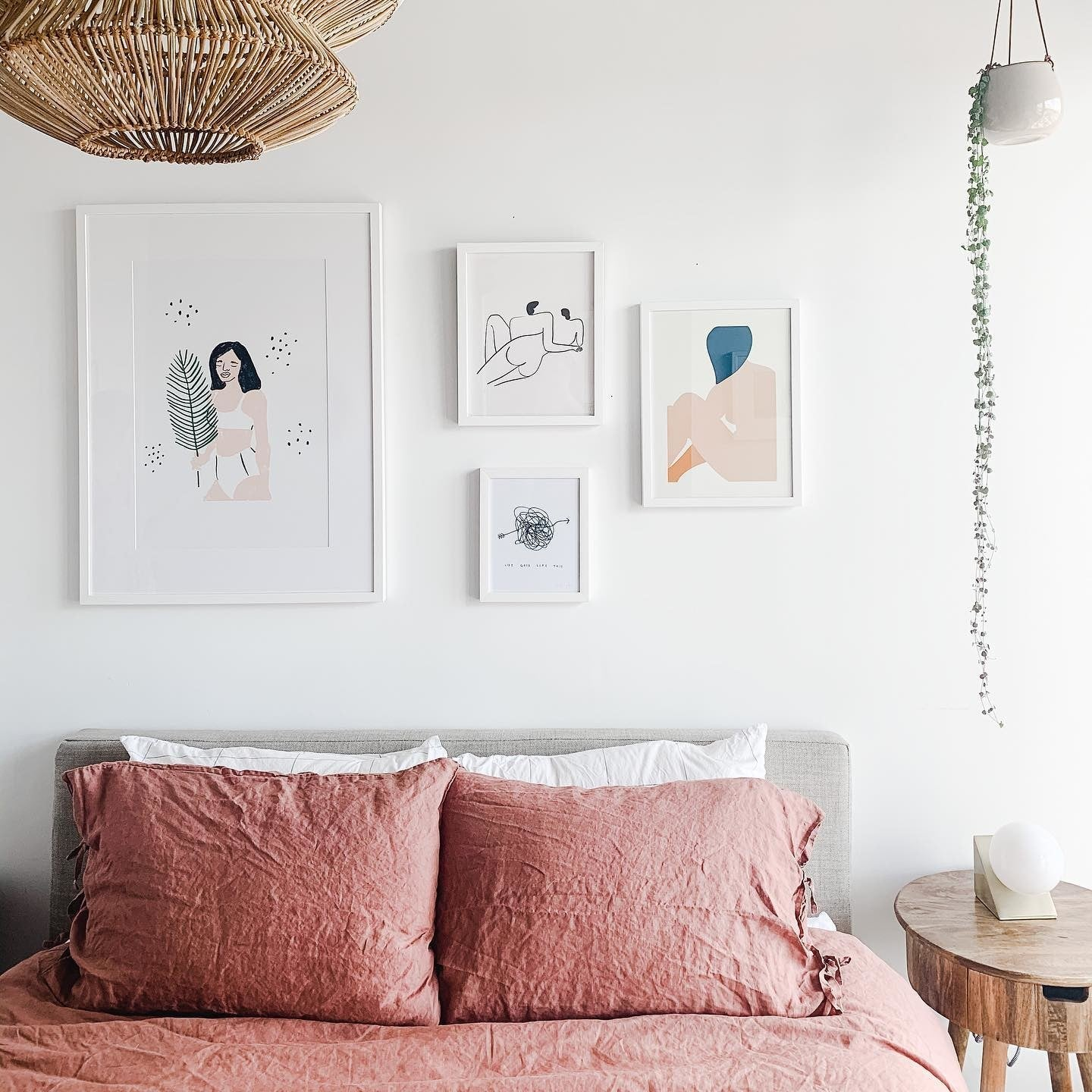 Bedroom Gallery Wall of White Framed Prints