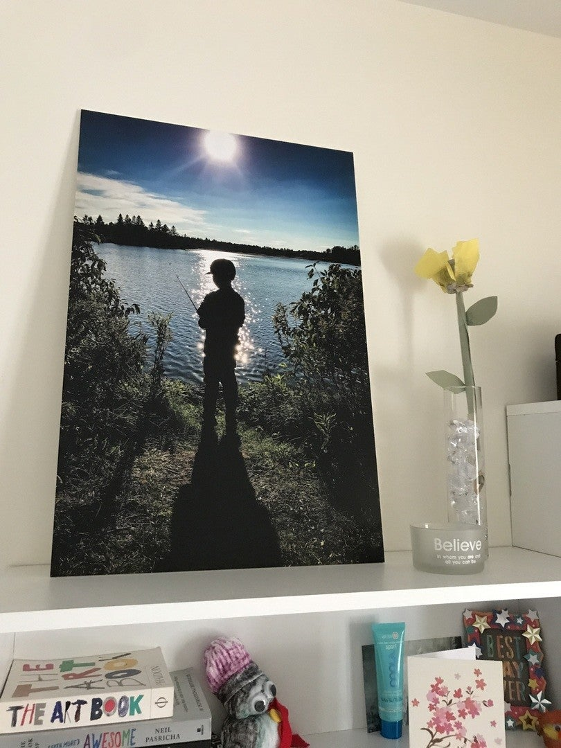 Photo of a Child Fishing, Printed on a Posterjack Photoboard
