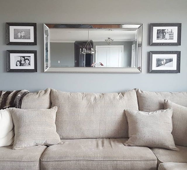 Featured Gallery Wall of Family Photos in Living Room