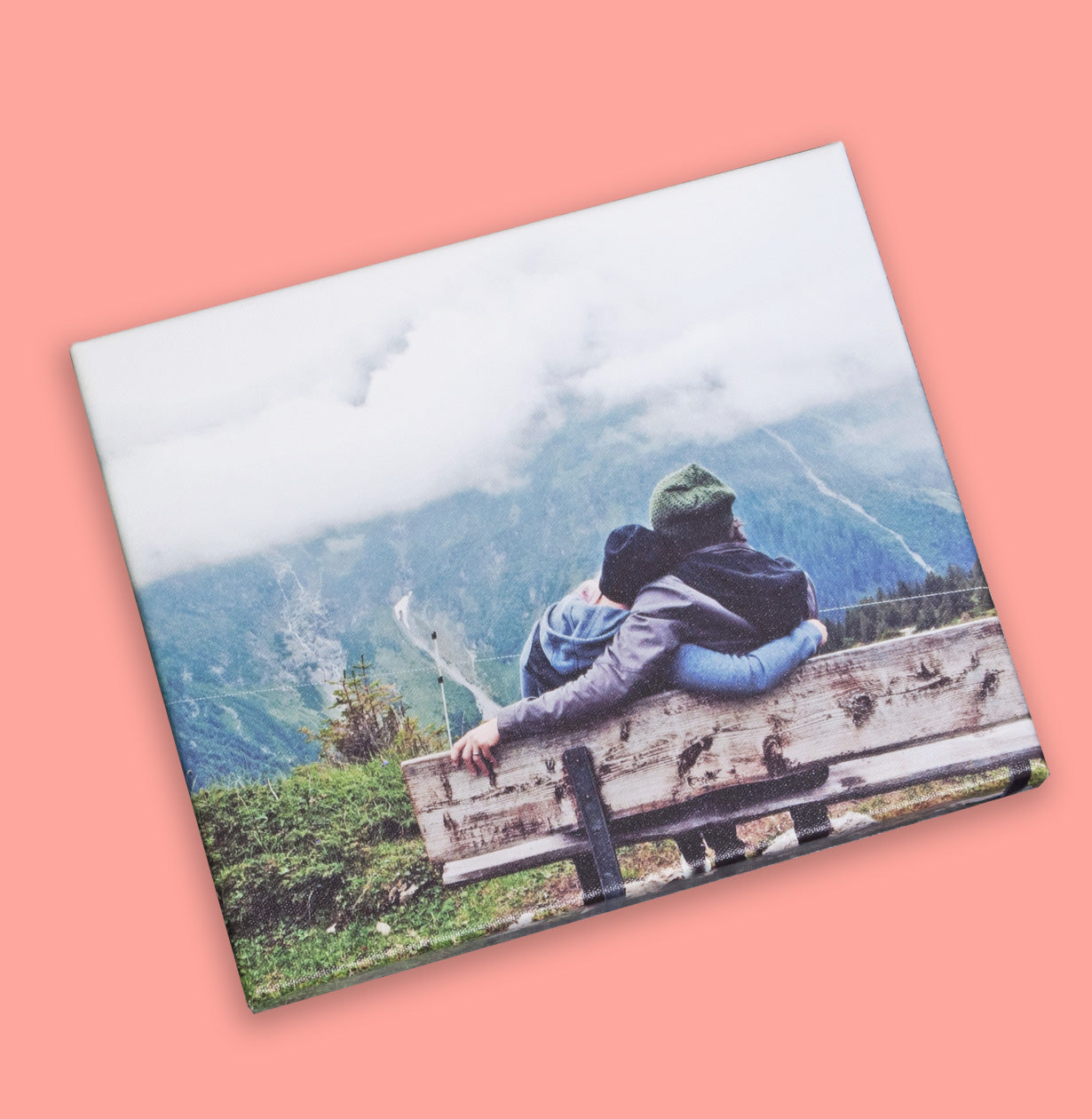 Photo of a couple sitting on a bench printed on canvas by Posterjack