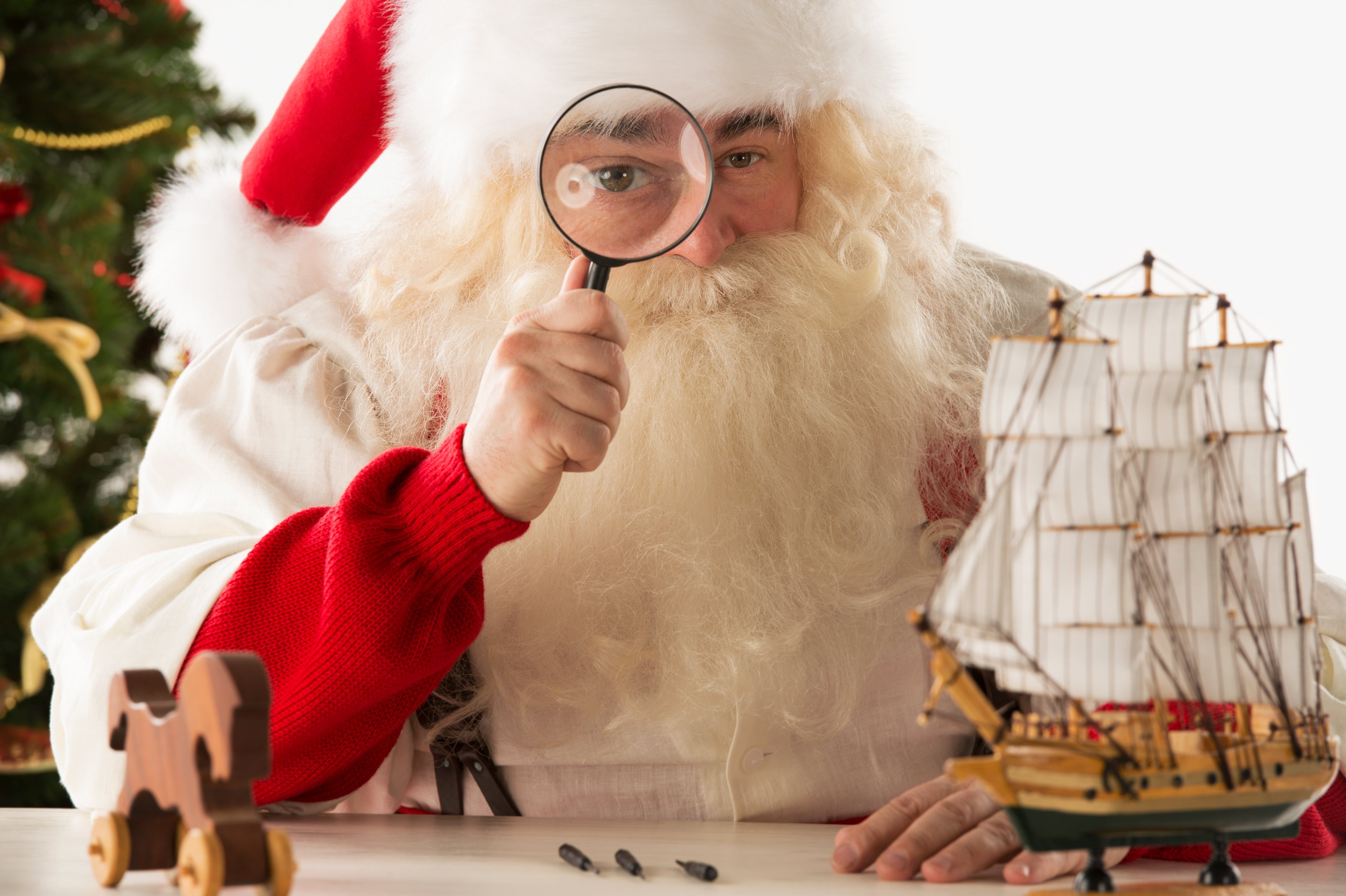 Santa with Magnifying Glass