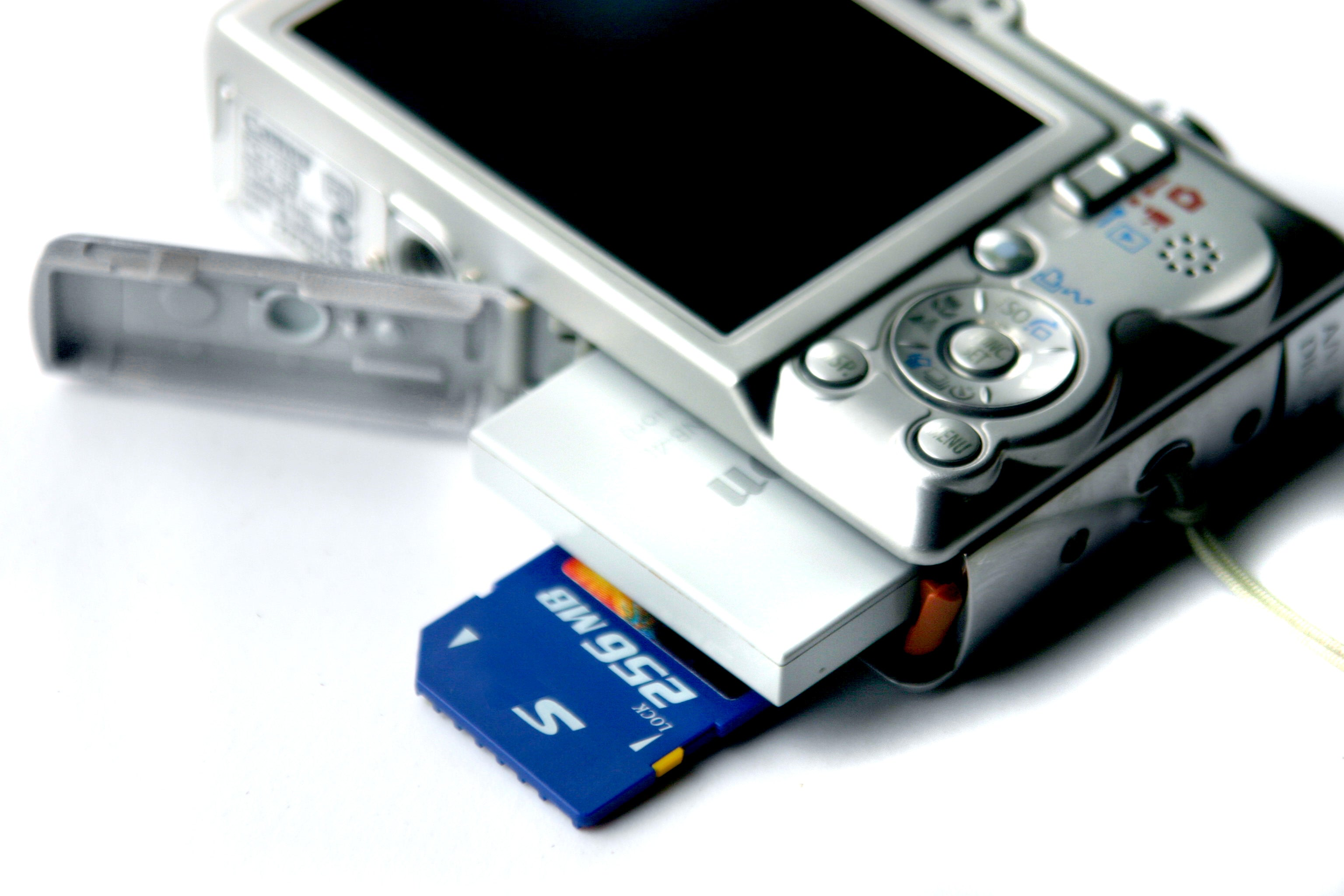 Digital camera with battery and memory card
