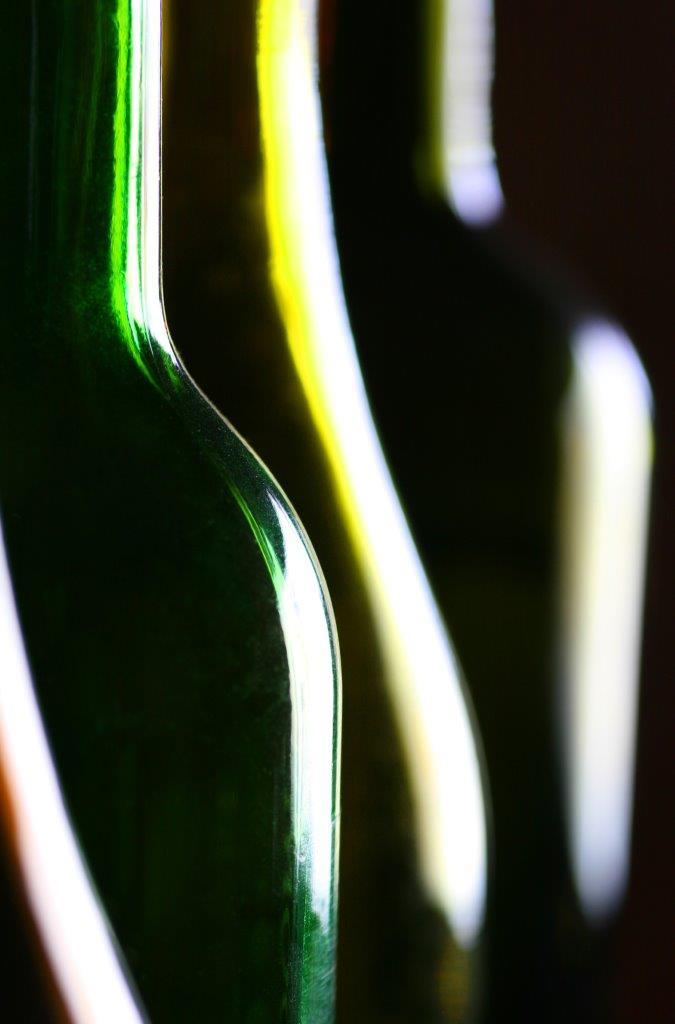 Close-up photo of coloured glass bottles illustrating the use of curved leading lines