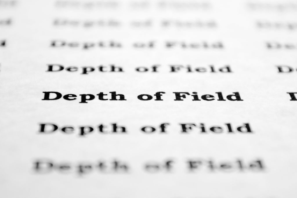 """Depth of field"" typed on paper in and out of focus"