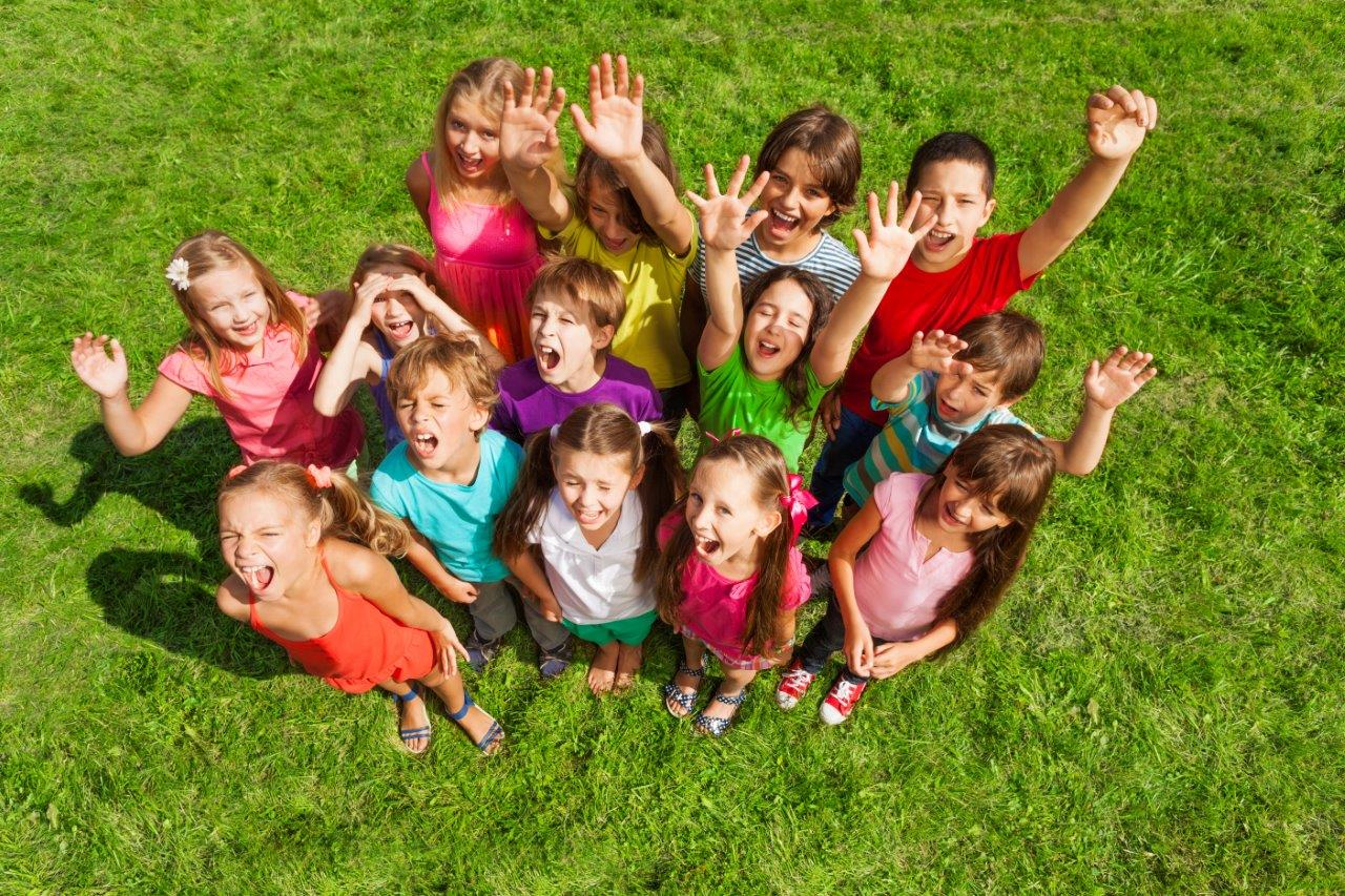 Group photo of children looking up at the camera