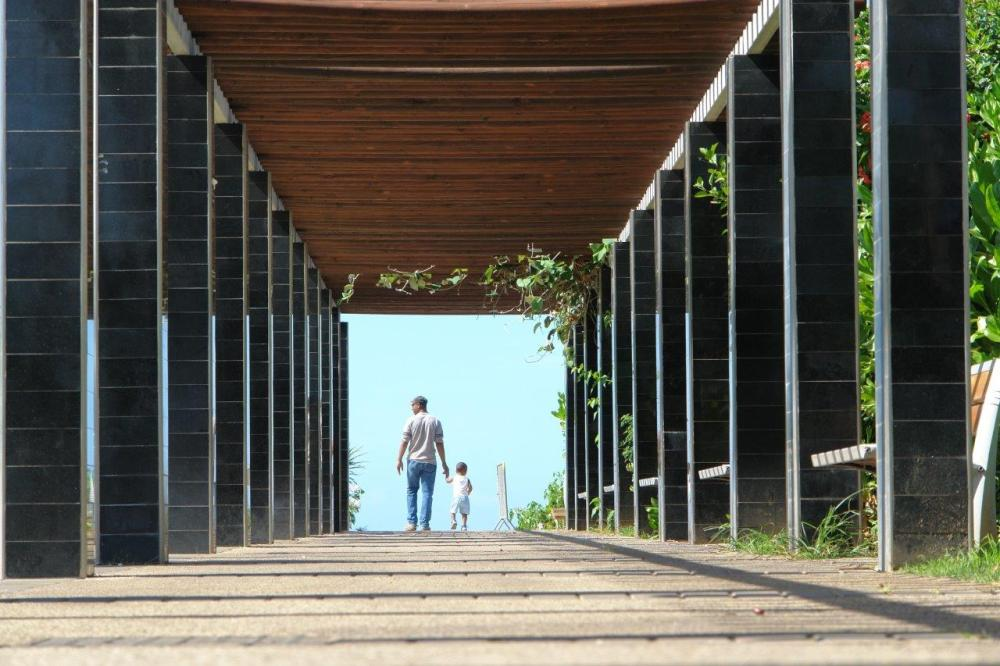 Man and child walking under a bridge as an example of compositional framing