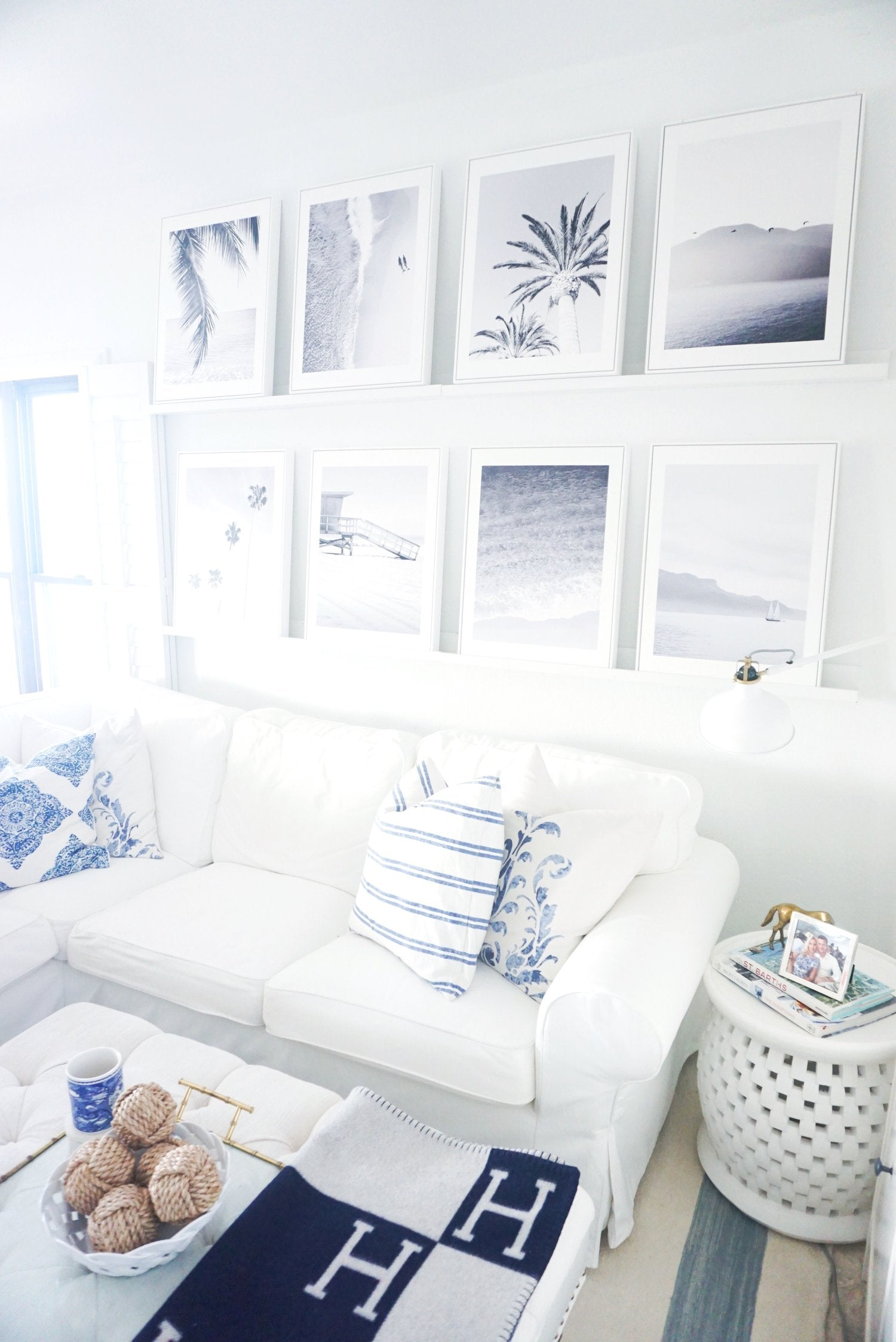 Gallery Wall of White Shadow Box Floater Frames Displayed in Living Room