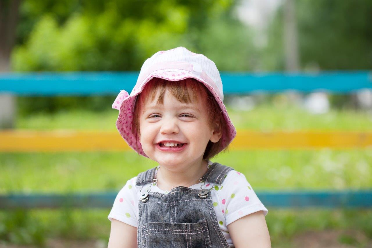 Portrait of a little girl with a big smile - understanding your digital camera's scene modes