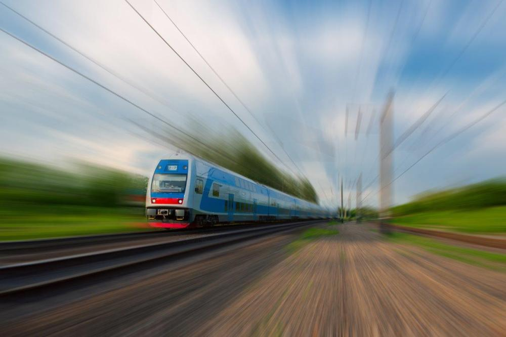 Train with motion blur on railroad tracks - example of diagonal leading lines in photography