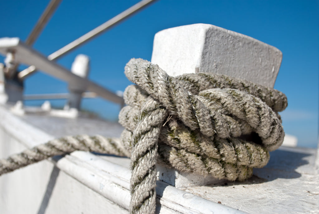 Close-up photo of rope tied to a boat on the ocean