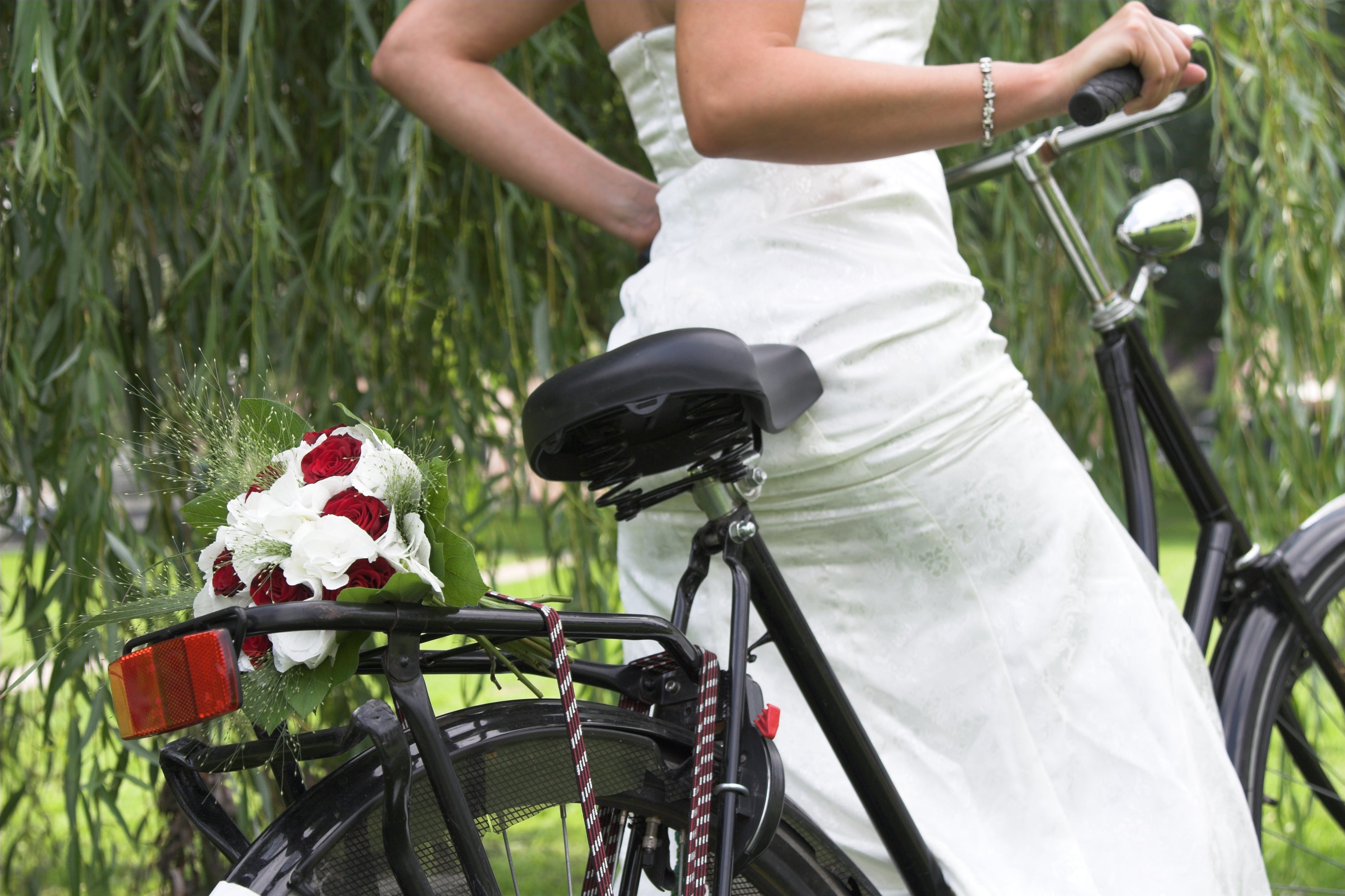 Wedding flower bouquet and bride on a bicycle