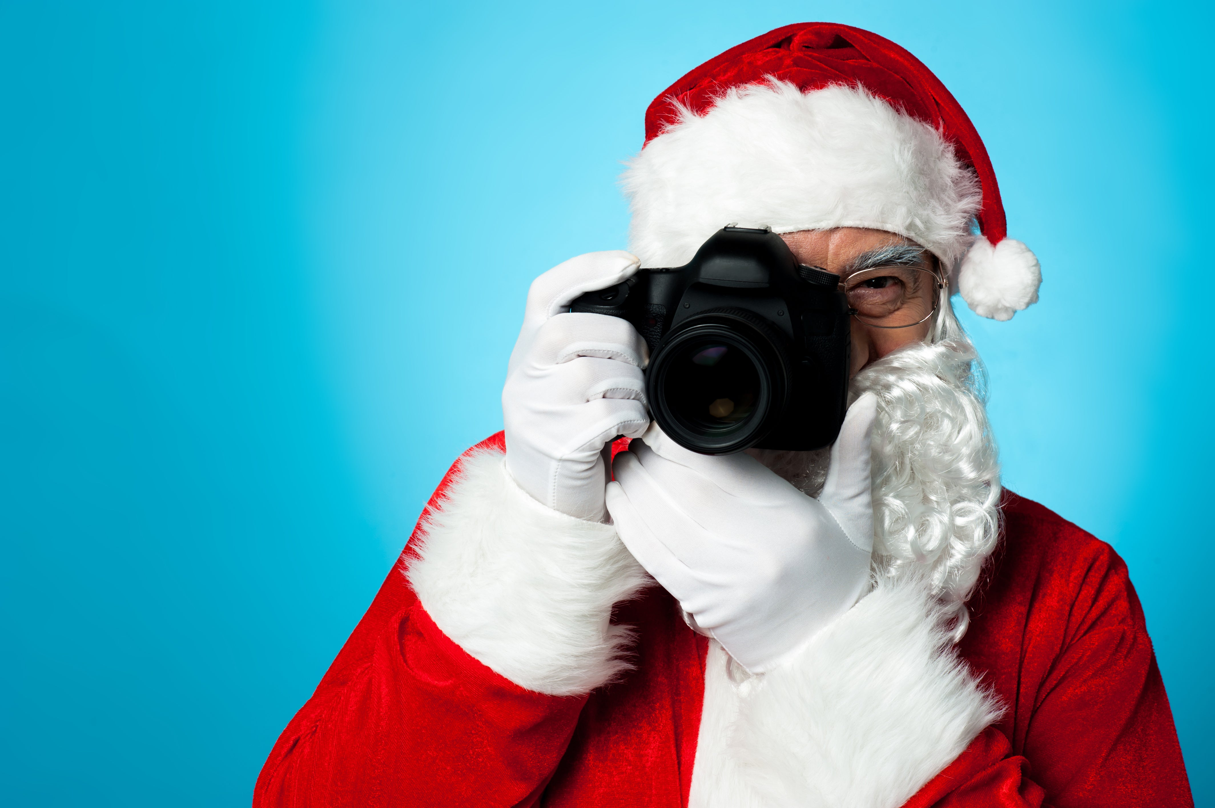 Santa holding a digital camera