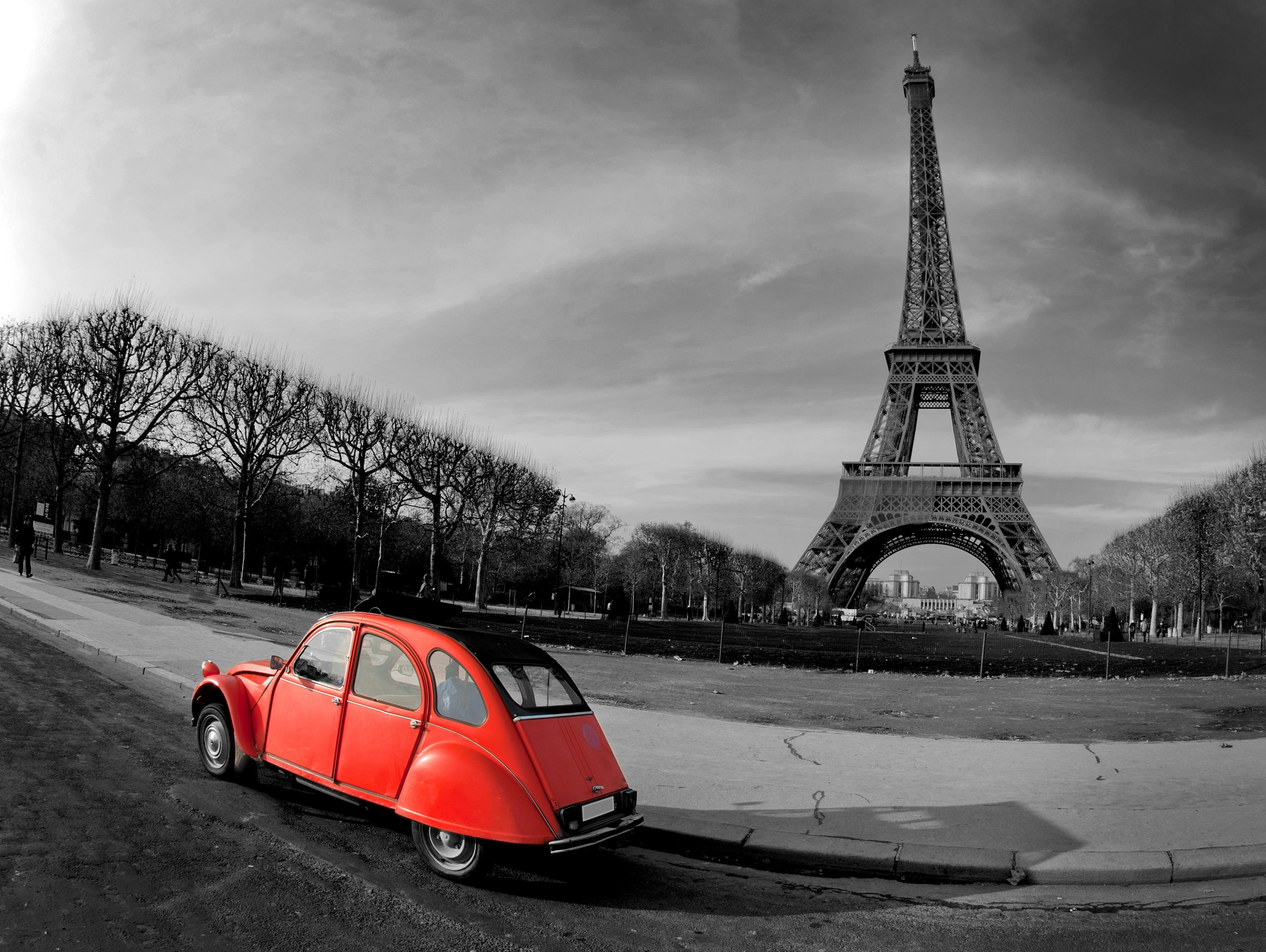 Eiffel Tower and red car in Paris