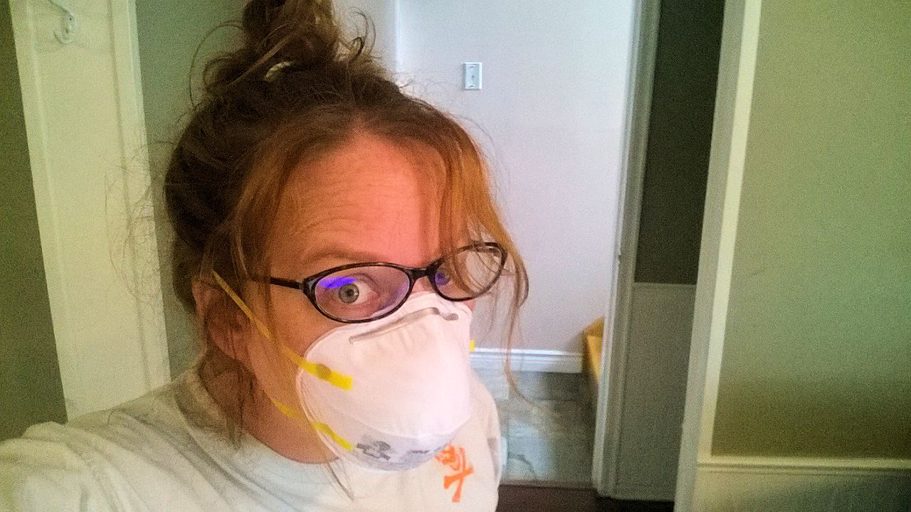 Room makeover selfie with hair up and gloves and mask on