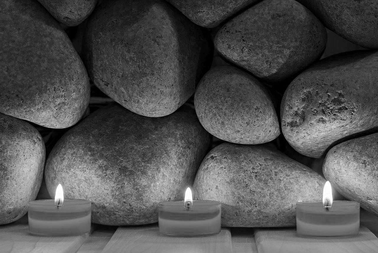 Burning candles in black and white, illustrating how to take photos in low-light situations