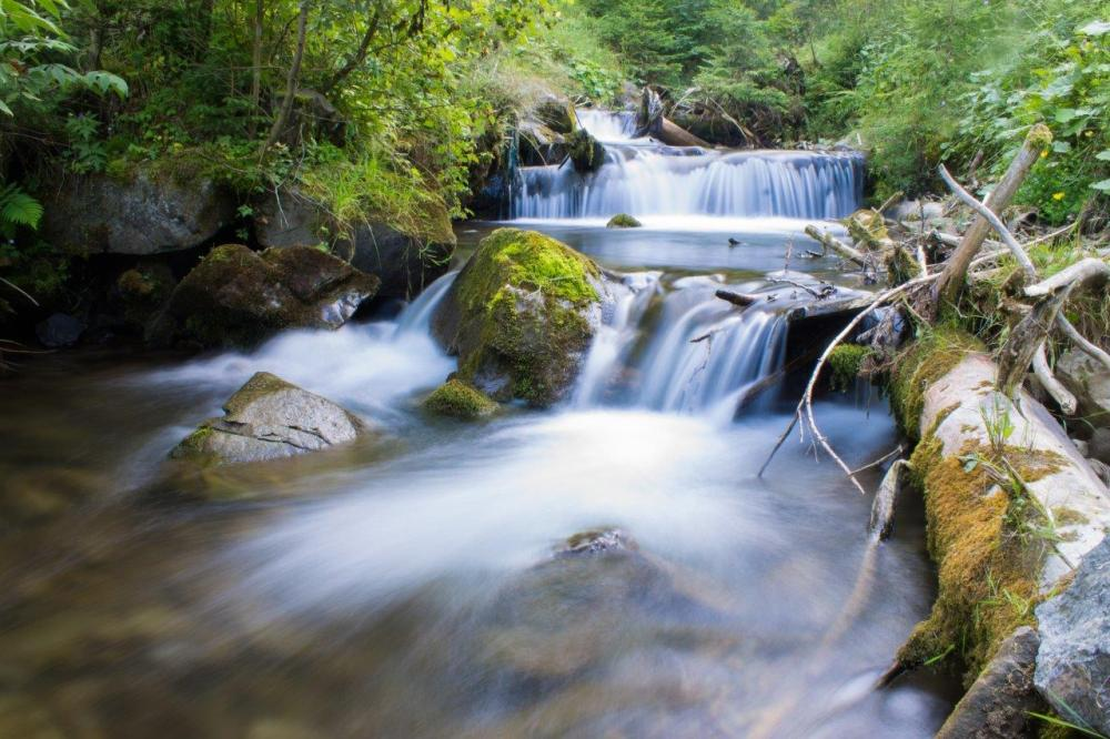 A small, beautiful waterfall captured with a slow shutter speed