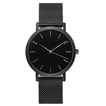 Quartz thin faced watch with black face