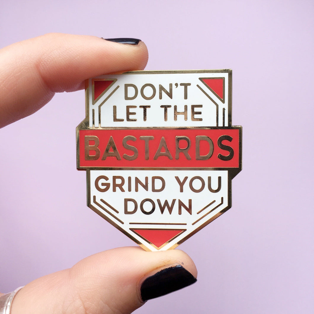 Don't let the bastards grind you down Enamel Pin