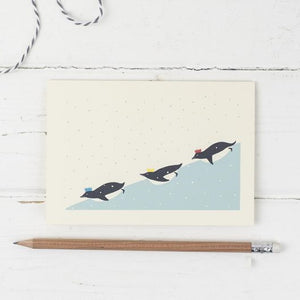 Penguins on ice- Christmas greetings card