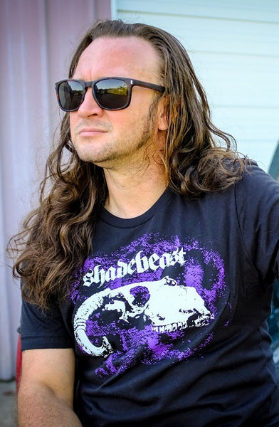 "Shadebeast ""Depredation"" tee and bumper sticker bundle, white/purple on black"
