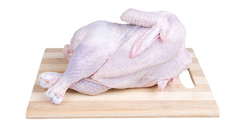 Raw chicken relaxing on a board