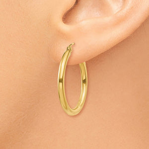 Alternate view of the 2.5mm x 25mm 14k Yellow Gold Classic Round Hoop Earrings by The Black Bow Jewelry Co.