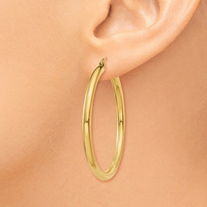 Alternate view of the 3mm x 40mm 14k Yellow Gold Classic Round Hoop Earrings by The Black Bow Jewelry Co.