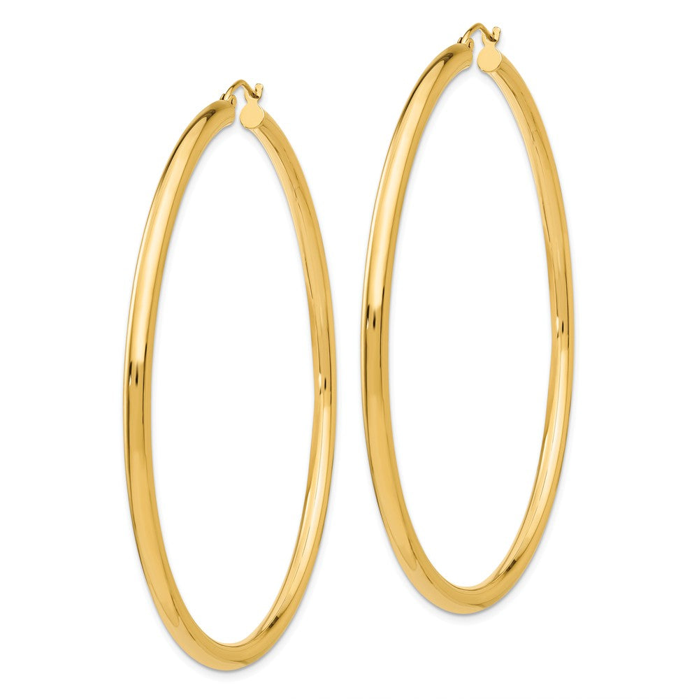 Alternate view of the 3mm x 65mm 14k Yellow Gold Classic Round Hoop Earrings by The Black Bow Jewelry Co.