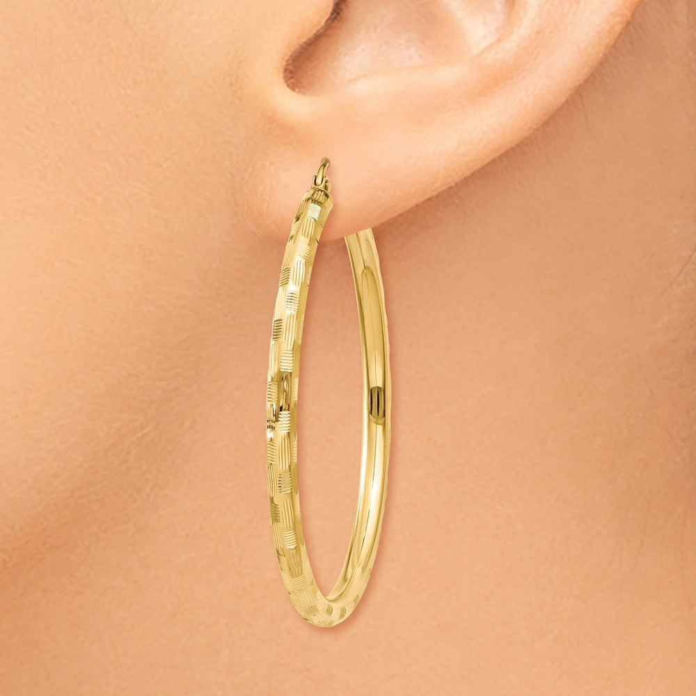 Alternate view of the 3mm x 45mm 14k Yellow Gold Textured Round Hoop Earrings by The Black Bow Jewelry Co.