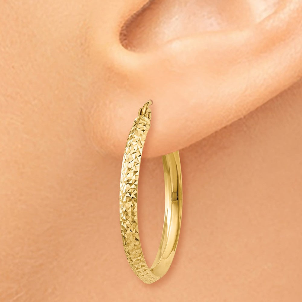Alternate view of the 2.5mm x 25mm 14k Yellow Gold Knife Edge Diamond-Cut Round Hoops by The Black Bow Jewelry Co.