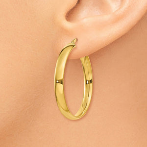 Alternate view of the 4mm x 28mm Polished 14k Yellow Gold Round Hoop Earrings by The Black Bow Jewelry Co.