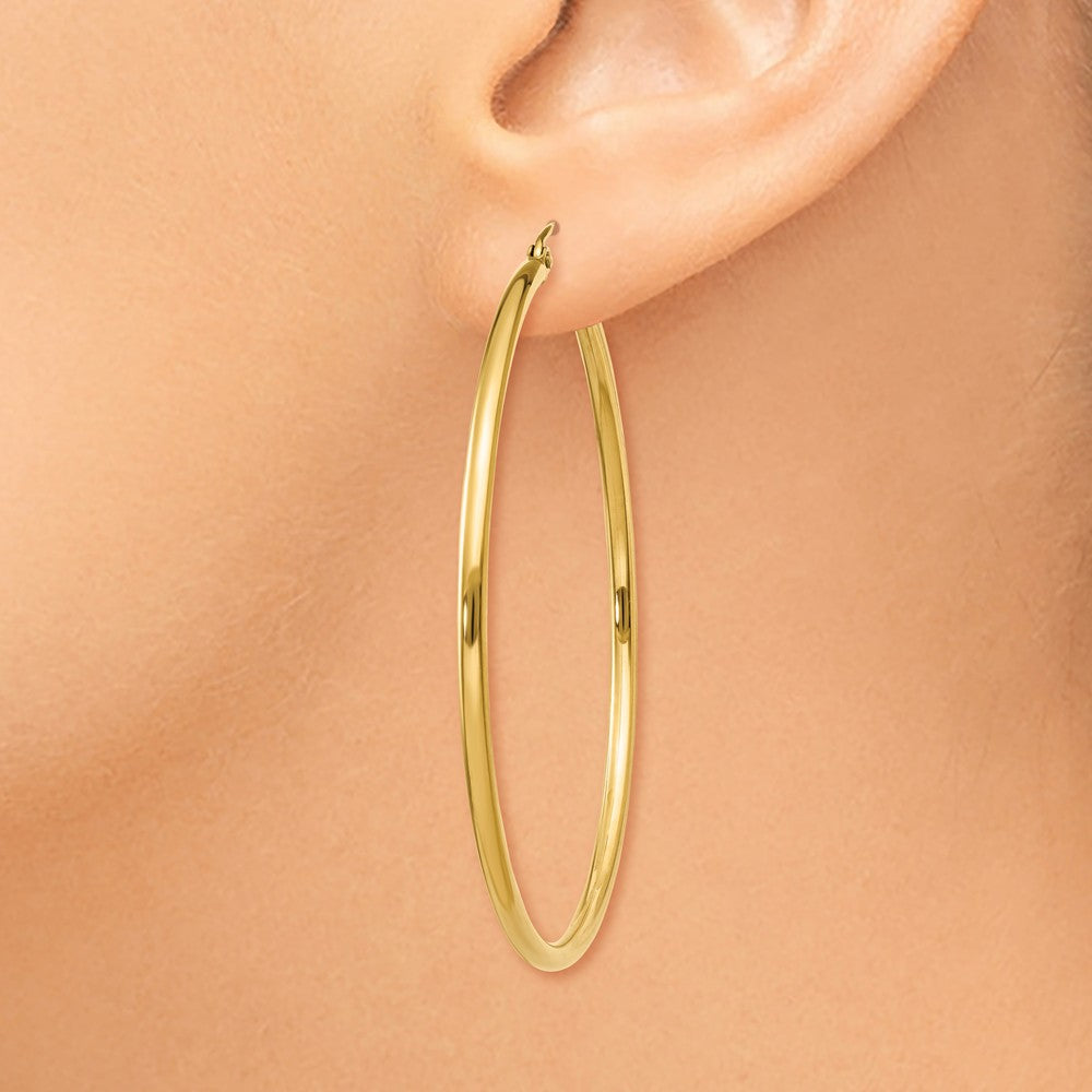 Alternate view of the 2mm, 14k Yellow Gold Classic Round Hoop Earrings, 50mm (1 7/8 Inch) by The Black Bow Jewelry Co.