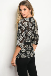 Ladies embroidered detail wrap top