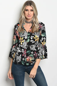 Ladies fashion 3/4 sleeve floral print blouse that features a v neckline