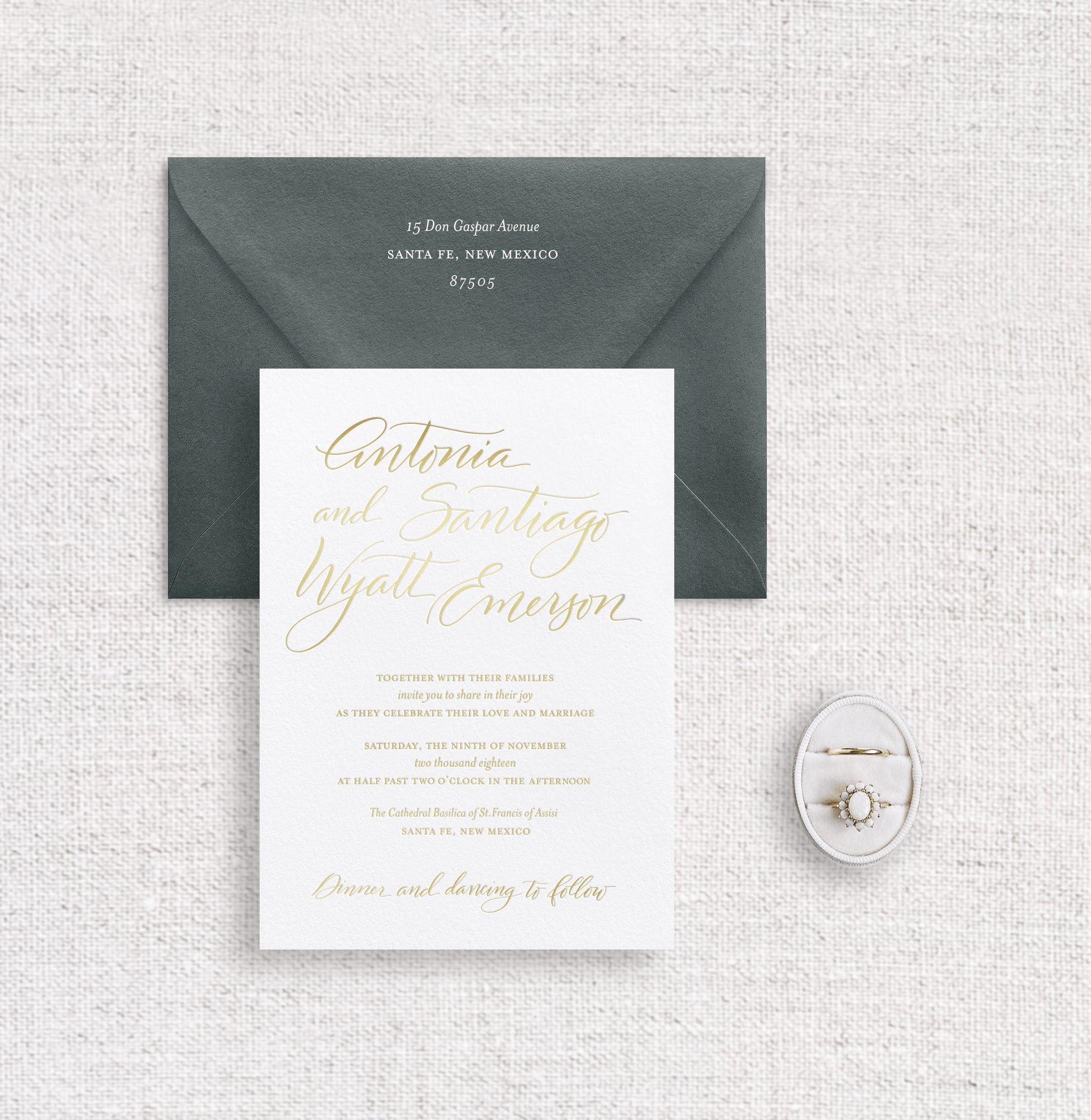 Antonia invitation foil stamped in champagne foil on white stock and racing green envelope digitally printed in white ink