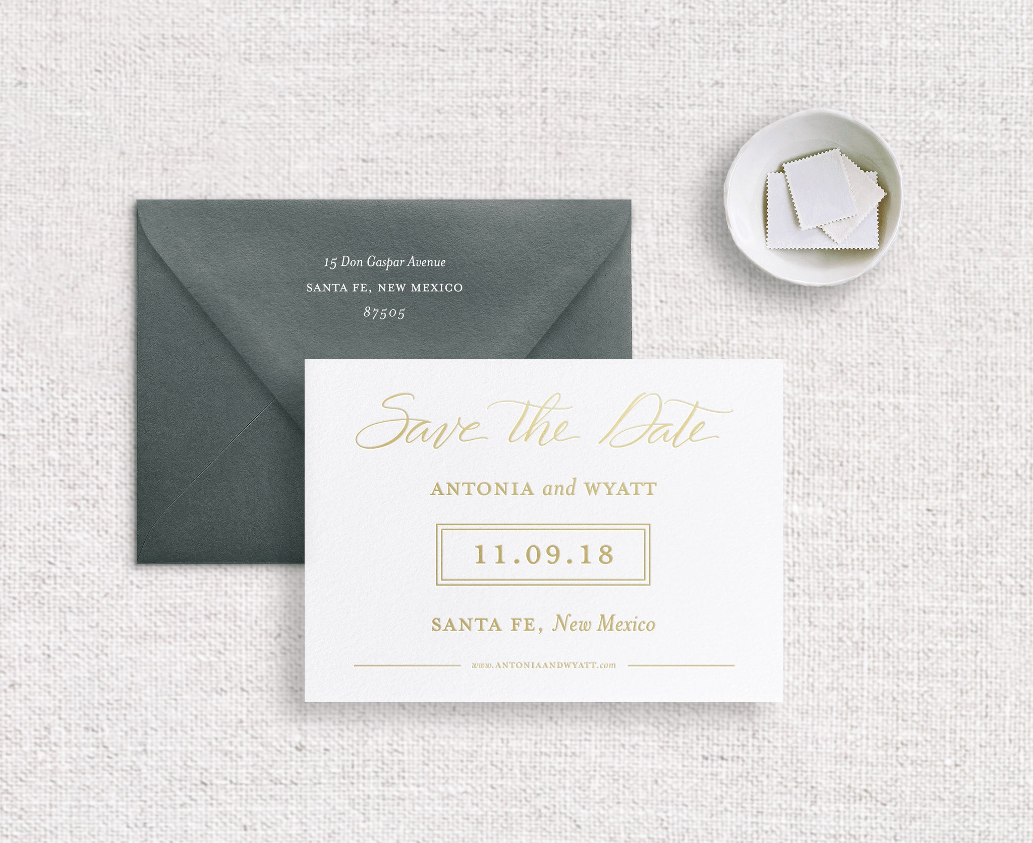 Antonia save the date foil stamped on white stock with champagne foil and racing green envelope digitally printed with white ink