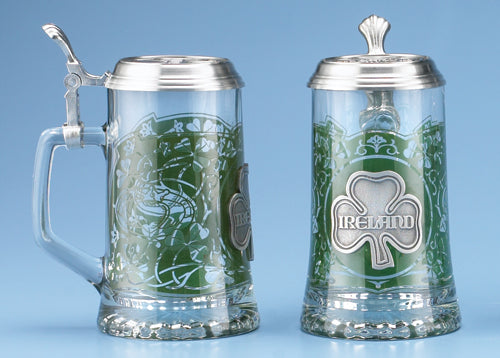 This stein is a salute to all of Irish descent. It is decorated with a translucent wrap-around emerald motif featuring numerous shamrocks. The claddaugh symbol is on both the left and right side of the stein. A pewter shamrock medallion appears opposite the handle. The pewter lid is also adorned with a relief pewter shamrock motif.