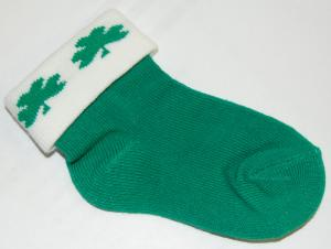 Green baby sox with shamrocks on cuff.
