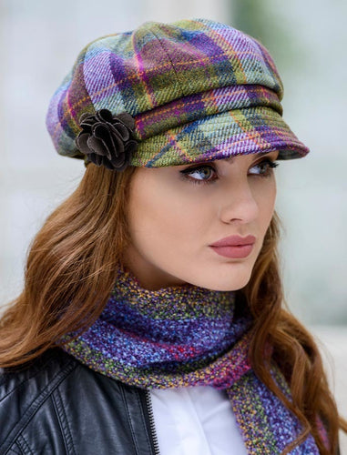 Our Newsboy hat offers a retro feel with an updated twist. The sleek and stylish shape of this cap is accented by the abstract flower detail on the side. Available in a wide variety of colours.  100% Wool with elasticated back for comfort fit. One size fits all