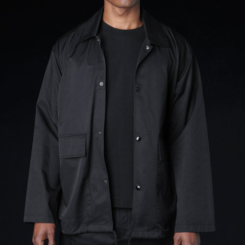 Water Roll Off Coach Jacket in Black
